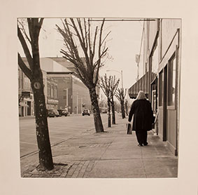 Photo of woman walking down street.