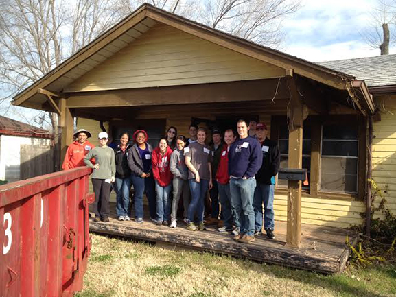 UA students stand in front of a house they renovated in Moore, Oklahoma, for tornado survivors.