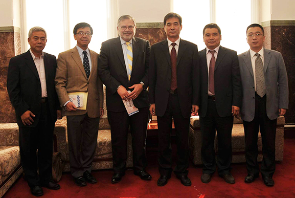 Robert Olin and Luoheng Han with representatives of Jilin Agricultural University in China