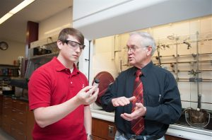 Dr. Anthony J. Arguengo III works with student Wesley Taylor.