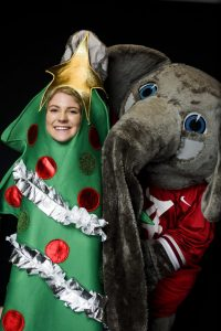 student in a Christmas tree costume next to Big Al