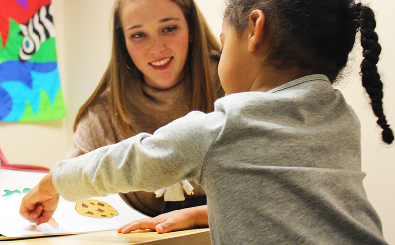 a student works with a young child in the psychology department