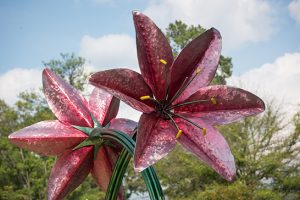 large metal sculpture of two flowers