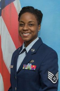 """As a crypotologic language analyst for the Air Force, Woody has stood out to her superiors and peers as a """"once-in-a-career type individual."""""""