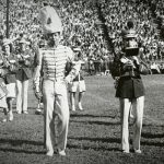 Members of the 1945 band standing on a football field.