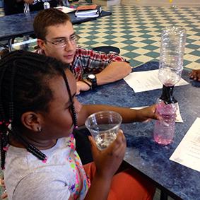 UA student Andrew Davis with a Matthews Elementary student
