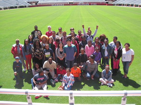 Victory Through Voices participants at Bryant-Denny stadium