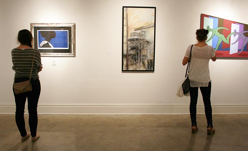 Two students observe art in the Sella-Granata Gallery