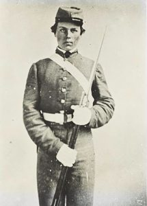 a young man in a cadet uniform