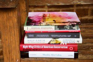 seven books stacked horizontally