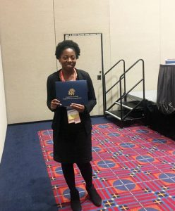 Candace Chambers with her award