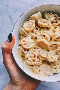 Some of Kitchen's favorite recipes include surprising ingredients that help her find her healthy life balance. Her vegan mac and cheese, shown above, includes ingredients like roasted squash and cashews.