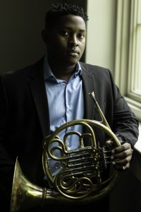 Joshua Williams with his horn