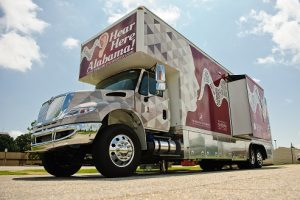 a truck emblazoned with the words hear here, alabama