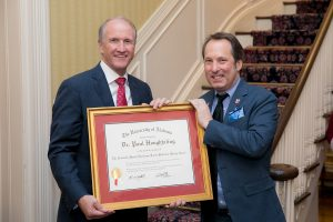 UA President Stuart Bell presents the Blackmon-Moody Award to Dr. Paul Houghtaling