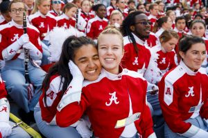 Members of the Million Dollar Band pose in the stands of Bryant-Denny at a football game.
