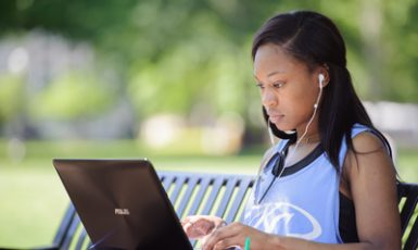 a student studying on the Quad