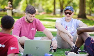 male students studying on the Quad