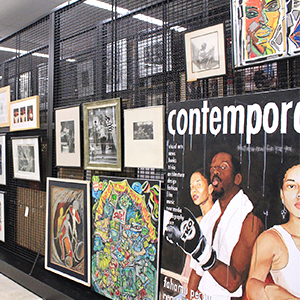 various works of art by American artists hang in an archive space