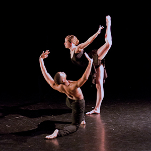 a pair of dancers performing on stage