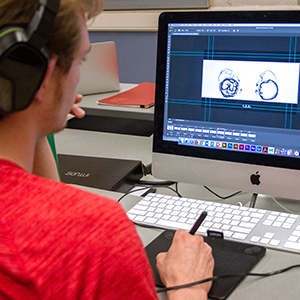 a student creating art using a computer