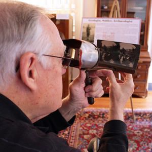 historian looking through a scope