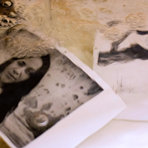 black and white photographs lying on a table in the studio