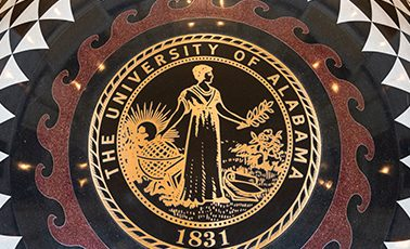 the floor of the Shelby Hall rotunda, showing the UA seal