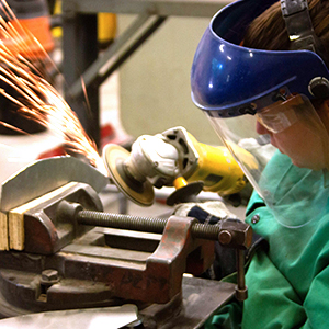 a student works on a metal sculpture