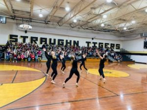 Dancers perform for elementary school students