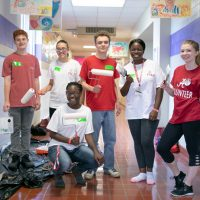 students participating in the Embrace Tuscaloosa service project