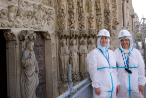 Dr. Jennifer Feltman and Iliana Kasarska standing in front of the Cathedral of Notre Dame's Last Judgment portal